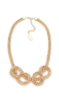 Love this necklace , its light weight  even though it doesnt look it . you can dress it up or down. It's great!!! Adia  Kibur Knot Necklace