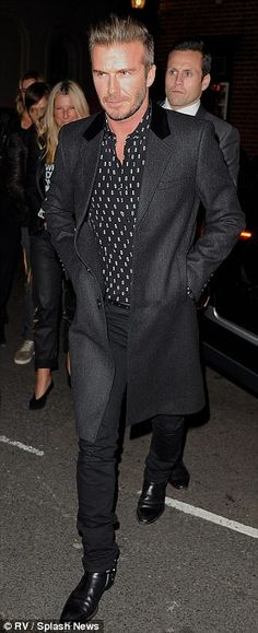 Oh so coordinated: Victoria and David Beckham looked as stylish as ever as they arrived at...