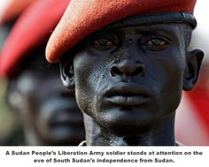 simply-war: A Sudan People's Liberation Army soldier stands in line during a rehearsal of the Independence Day ceremony in Juba July (Goran Tomasevic/Reuters)