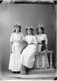Glad Lucia! Swedes celebrate Saint Lucy's Day on December 13. With candles in their hair, songs, and saffron buns. These women were photographed in 1914.