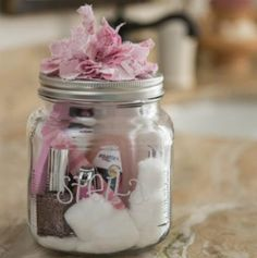 Make a manicure set in a jar~polish, cotton balls, remover, file & mini-clippers.   this would make an awesome birthday gift, 'stocking' stuffer, or a hostess gift for premier. (: