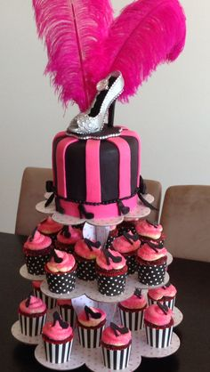 Nakes' Hens Party cake turned out perfect... Top tier was a checkerboard cake and the cupcakes were red velvet w cream cheese icing n hand made stiletto decos
