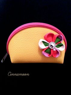 "Cinnamoon Accessory: ""Sunshine purse""  Sunshine yellow purse with a fuchsia pink zip decorated with a handmade cotton Kanzashi Flower.  This colourful design will cheer you up every time you open your secret pocket. Ideal as a gift for your loved ones or to treat yourself with a touch of spring beauty.  Discover more Kanzashi designs:   https://www.etsy.com/shop/cinnamoonboutique?ref=hdr_shop_menu  https://www.facebook.com/pages/Cinnamoon/859467174093940?fref=photo"