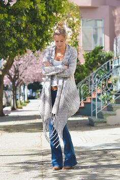 Flare Jeans Outfit Ideas - spring / summer - street chic style - boho chic style - flare jeans + brown belt + white tank top + brown heel booties + grey fringe blanket sweater