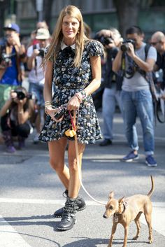 Anna Dello Russo's ultimate accessory? Her adorable pooch. #MFW #StreetStyle