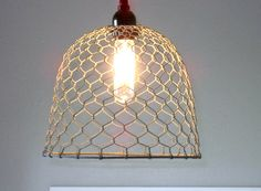 """What a light!! Made with a grey galvanized type wire that looks just like an old chicken coop. This would make a great addition to any kitchen, laundry room, mudroom, barn, etc. The dome is 10"""" in dia"""