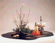 CHIKO SCHOOL arrangements generally include some accessories, such as seasonal fruits or vegetables, ornament, doll, or other artistic or folk object, in addition to the container and floral materials.