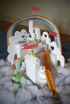 Care Bear Rainbow Cloud City - featuring a Styrofoam Cutter. I want one. Also, doesn't have to be Care Bears. I think a rainbow cloud city would go over well any way it comes.