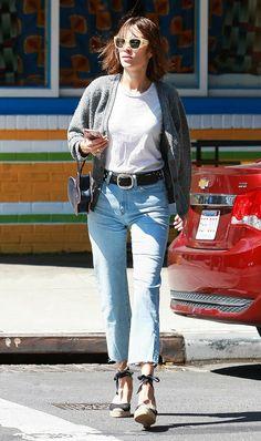 Alexa Chung wears the perfect errands outfit in cropped flares, ankle-tie espadrilles, a white tee, and chunky cardigan.