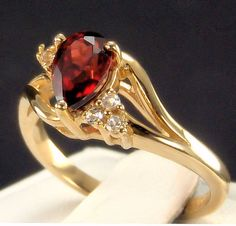 Mozambique Garnet Pear Solitaire with White Sapphire Accents Solid Gold Ring 14k Gold Ring, Red Garnet, White Sapphire, Yellow Gold Rings, Solid Gold, Fine Jewelry, Jewels, Gemstones, Pear