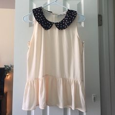 Adorable Collared, Sheer Peplum Top This top is perfect for any summer occasion. It is in perfect condition and is so light and breezy. I always get compliments when I wear it. Kind of preppy, kind of quirky, but definitely cute. Macy's Tops Blouses
