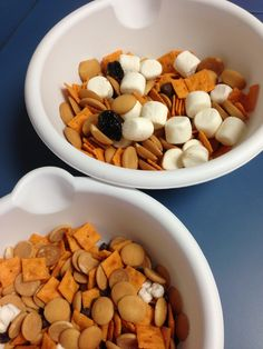 "Snack/language activity for preschool - big and little ""trail mix.""  We used jumbo and mini marshmallows, large and regular Cheez Its, regular and mini Vanilla Wafers, raisins and dried plums, and chocolate chips and Hershey Kisses. We even used a big and little bowl and a big and little spoon for mixing. We talked about the colors, shapes, texture, etc. Great language activity!"