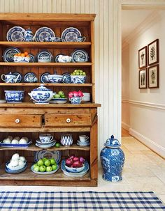 Great collection of blue and white china. Looks splendid against the warm pine wood....