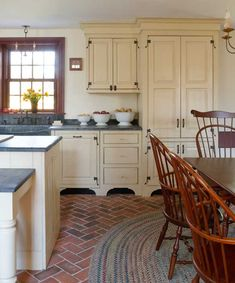 Designing a New Country Kitchen - Old-House Online    Wonderful cabinets and hardware