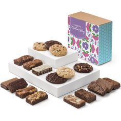 The perfect food gift for all the dessert-loving mothers out there. Fairytale Cookies and snack-size brownies together in one delightful gift. The assortment includes six cookies - Toffee Chocolate Chip, Caramel Pecan, Chocolate Chip, Double Chocolate, Coconut Walnut and Mint Chocolate - and 12 snack-size brownies (Sprites) - Caramel, Chocolate Chip, Mint Chocolate, Original, Pecan, Raspberry Swirl, Toffee Crunch, Walnut, White Chocolate, Espresso Nib, Cream Cheese, Cinnamon Cocoa. Chocolate Toffee, Caramel Pecan, Mint Chocolate, Chocolate Espresso, Cookie Gift Baskets, Cookie Gifts, Food Gifts, Mother's Day Cookies, Fall Cookies