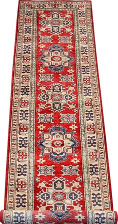 Today's Kazak is a modern shape of old Caucasian rugs which strictly adheres to traditional design elements of the Caucasus. It has elements such as the stepped hooked polygons, geometrical medallions and rosettes, presented in more stylized manner and with a new dimension.  http://www.alrug.com/4716