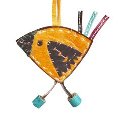 $12 Strolling Bird Ornament. North African Tuareg style comes to ornament making. Tuareg leatherwork traditionally includes camel bags, saddles and harness. Come pick up this fair trade goodie at Ten Thousand Villages in Boston.