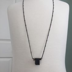 Raw Black Tourmaline chunk (Brazil) and sterling accent beads strung on long braided, beaded cotton cord necklace by MiiMyxJewelry on Etsy https://www.etsy.com/listing/216175433/raw-black-tourmaline-chunk-brazil-and