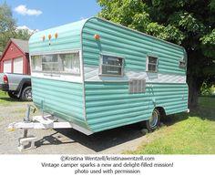 Cute aqua vintage camper!