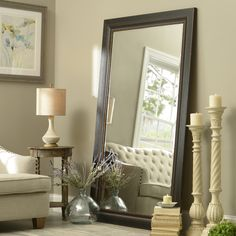 Enjoy this stunning 46x76 Black Framed Mirror for your home. This large mirror is eye-catching both leaning or hung on a wall. Don't be afraid to go bold in your living room!
