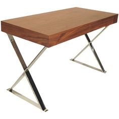 A stately addition to your living room or home office, this wood writing desk showcases 2 drawers and x-shaped metal legs.  Product:...