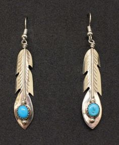 Sterling Silver and Turquoise Feather Earrings.