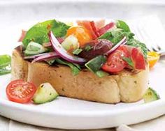 Grilled Mediterranean Bread Salad Recipe - A new take on bread salad! A tangy vinaigrette dressing tossed in crisp, crunchy Romaine and served with extra thick slices of grilled garlic Texas toast #Schwans #EasyRecipes #Inspiration