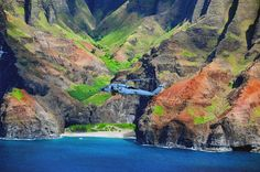 Helicopter in RIMPAC 2014, Stuart Rankin Edited USN image of a helicopter flying Kauai, Hawaii during RIMPAC 2014.
