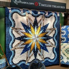 The Lumina Feathered Star is glowing! Made out of seasonal portrait fabrics designed by Judy and Judel Niemeyer and Timeless Treasures! Timeless Treasures Fabrics, Inc.