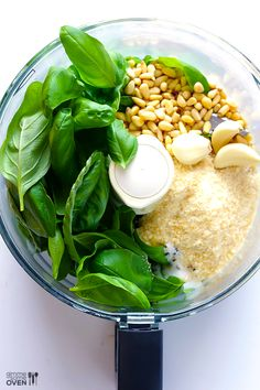 1/2 cup pine nuts 3-4 cloves garlic (I think the more, the merrier!) 3 cups fresh basil leaves, packed 1/2 cup freshly grated Parmesan 1/2 cup extra-virgin olive oil salt and freshly ground black pepper to taste (or about 1/2 tsp. of each.