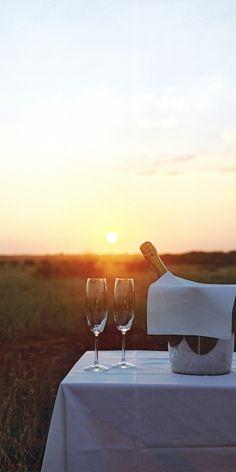 A honeymooners' sundowner at Makanyane Safari Lodge in South Africa.