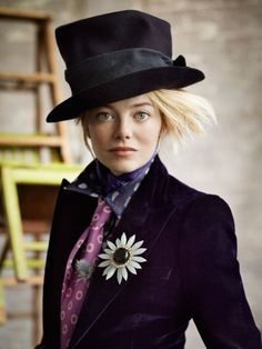 Chanelling a bit of the Mad Hatter, Emma? We like the slightly fried, frizzy, backcombed, straight tuft of hair that's peeping out. #EmmaStone #hair