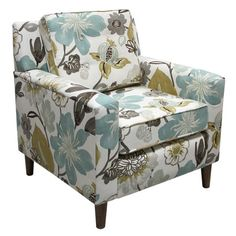 A blooming floral print gives this pine-framed arm chair's classic silhouette a fresh feel. Pair it with a plush shag rug for a dash of boho flair, or let it...