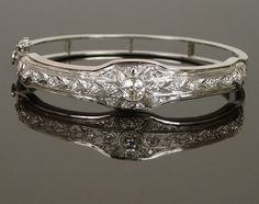 Elegant bangle bracelet.  This is made from a platinum and diamond Edwardian bar pin framed in a contemporary white gold bangle bracelet, making it much more wearable for today.
