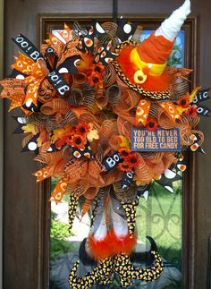 Candy corn witch Halloween wreath loaded with ribbons and accents