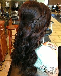Long dark hair. Curled. Braid