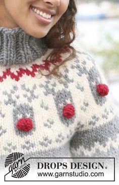 DROPS pulovr s raglánovými rukávy a vyplétanými soby pletený z příze Eskimo.