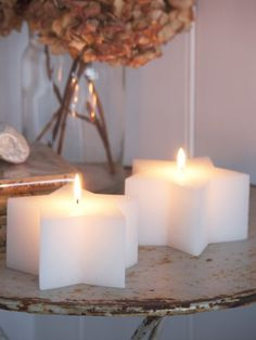 Love these little star candles - www.woudhof.nl