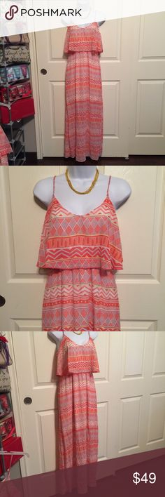 NWT Francescas pretty summer long maxi dress med NWT Francesca's pretty orange summer long maxi dress. Size medium. Call or orange and white with beautiful design. Sheer lightweight soft with lining. Women's Ladies Fashion. Check out my closet, we have a variety of women's, Victoria Secret, handbags 👜 purse 👛 Aerosoles, shoes 👠fashion jewelry, necklace, clothing, dress, Beauty, home 🏡 .  Ships via USPS. Smoke & Pet-Free. Offers 30% OFF bundle discount. Always a FREE GIFT 🎁 with every…