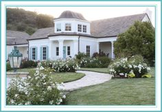 white with aqua doors and shutters