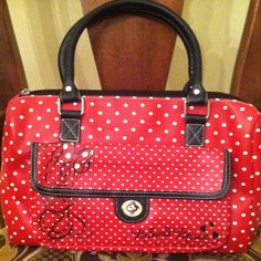 """Red/White Polka Dot Minnie Mouse handbag Authentic Disney original Minnie Mouse barrel style handbag! One compartment with interior zippered pocket. Outside pocket with twist lock closure! Measures 13x4x9 with 5.5"""" handle drop! Super cute and Bags"""