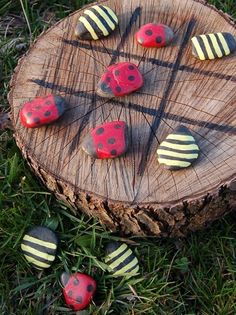 Tic tac toe with bumble bee and ladybug painted rocks and a tree stump.  Looove it!!!  Sorry, no tutorial...just the inspiration.