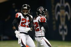 Dunta Robinson #23 and Asante Samuel #22 of the Atlanta Falcons celebrate after an interception against the New Orleans Saints