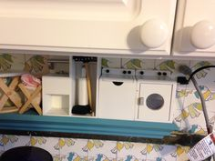 My newly redecorated laundry room - look how fun these wooden miniatures are.