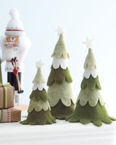 Growing up with a family who could never agree on a Christmas tree, we've gravitated towards DIY trees — make it exactly the way you want! This year we've really been drawn to felt tree projects, partly because they can be so festively colorful, but also because felt is a warm material, and easy to work with even for the less DIY-inclined.