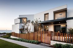 """Street elevation of """"Coastal Retreat"""" designed and built by Urbane Projects. Fencing, Coastal, Landscaping, Mansions, Street, House Styles, Building, Garden, Outdoor Decor"""