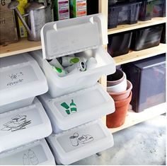 Recycle kitchen trash in stacked containers. Use labels on the bins to help organize bottles, cans and paper.