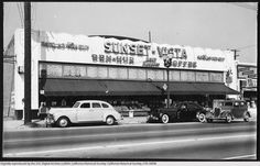 Exterior view of the Sunset-Vista Market showing three cars in front, taken from across the street, ca.1940