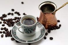 Turkish Coffee in a cup and cezve where it cooked