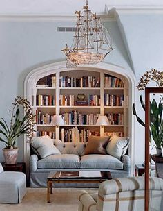 Love the bookcase but check out the chandelier..Chic beach decor..